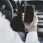 close-up-man-s-hand-holding-mobile-phone-with-blank-screen-car_23-2147873937.jpg